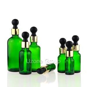ग्रीन ग्लास अत्यावश्यक तेल बाटली